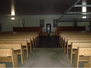 The inside of an Old Colony church.
